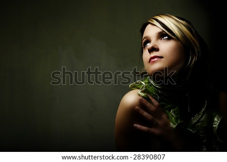 Fashion woman portrait  on dark background - stock photo
