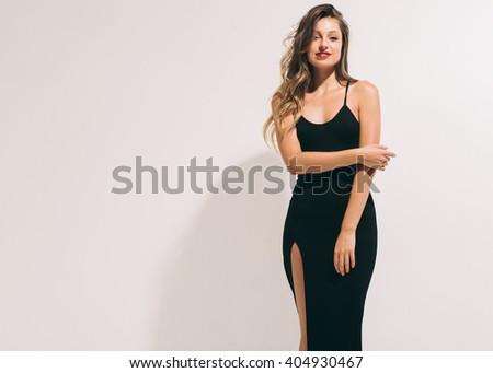 Fashion woman portrait sexy in black dress hot summer near white background  - stock photo