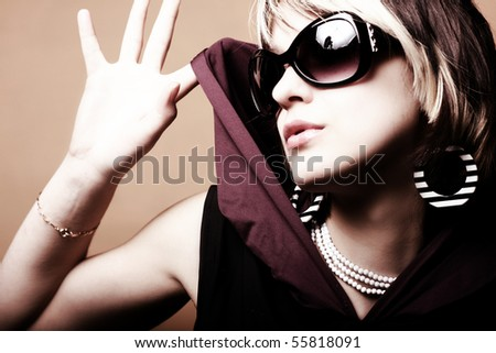 Fashion woman portrait wearing sunglasses - stock photo