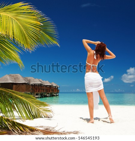 Fashion woman relax on the summer beach - stock photo