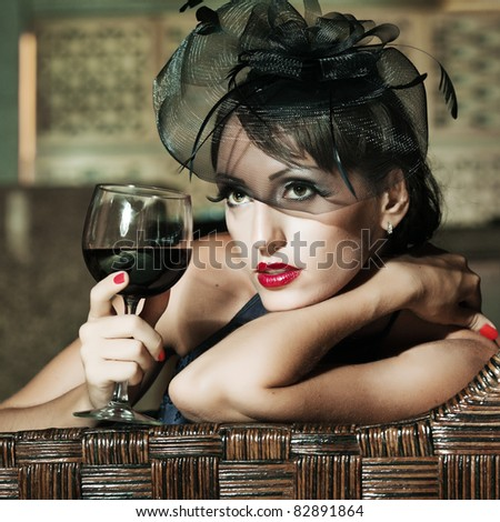 Fashion woman retro portrait in a restaurant - stock photo