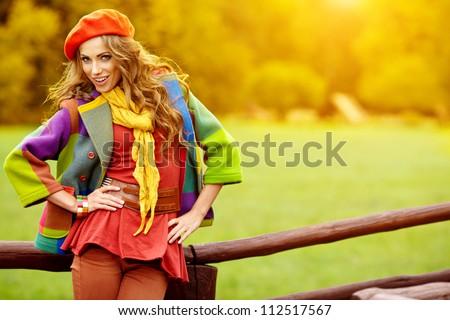 Fashion woman  walking in autumn park - stock photo