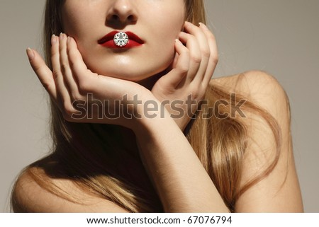 fashion woman with diamond in her lips studio shot - stock photo