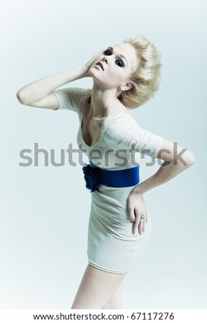 Fashion woman with hand in faces - stock photo