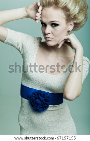 Fashion woman with hands in faces - stock photo