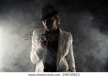 fashion woman with retro microphone in smoke - stock photo