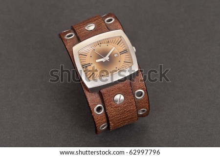 Fashion Wristwatch with Large Leather Strap - stock photo