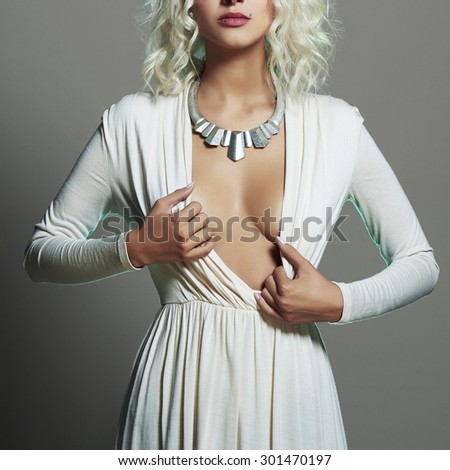 Fashion young beautiful woman. Sexy decollete blonde. Blond girl - stock photo