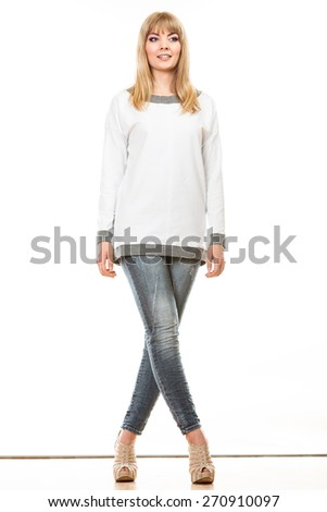 Fashion. Young blonde fashionable woman jeans pants white blank long-sleeved shirt. Female model posing isolated studio shot - stock photo
