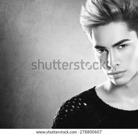 Fashion young model man portrait. Handsome Guy. Vogue style image of elegant young man. Black and white Studio fashion portrait.  - stock photo