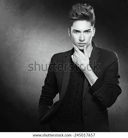 Fashion young model man portrait. Handsome Guy. Vogue style image of elegant young man. Studio fashion black and white portrait.  - stock photo