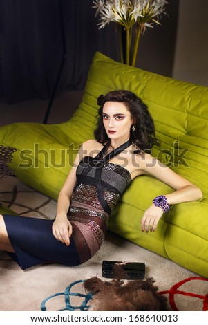 Fashion young model with make up, luxury look in interior - stock photo