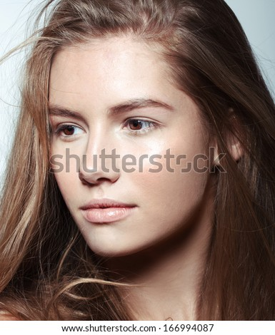 fashion young model with perfect skin and natural make up studio shot - stock photo