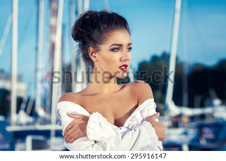 Fashion Young Woman Against Yachts Port. Glamour Style Summer Portrait - stock photo