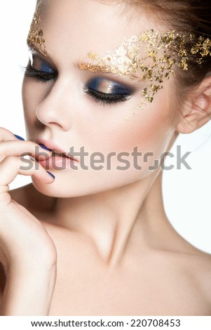 Fashion young woman - beauty gilded golden make-up. Luxury young face.  - stock photo