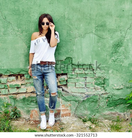 Fashion young woman posing outdoor  - stock photo