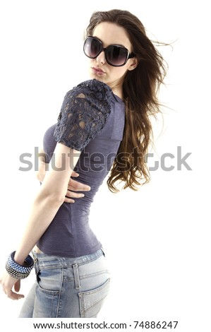 Fashion young woman wearing jeans with big sunglasses - stock photo