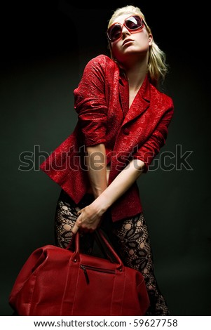 fashion young woman with red bag - stock photo