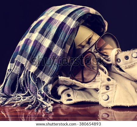 Fashionable accessories. Sunglasses, scarf and sneakers - stock photo
