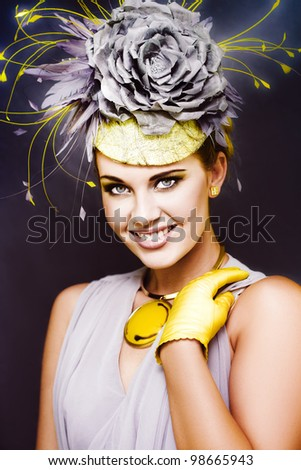 Fashionable And Gorgeous Young Female Model Wearing Flower Headwear, Gloves And Elegant Dress Posing At A Spring Carnival Horseracing Festival - stock photo