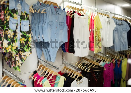 Fashionable apparel store with  shirts   - stock photo