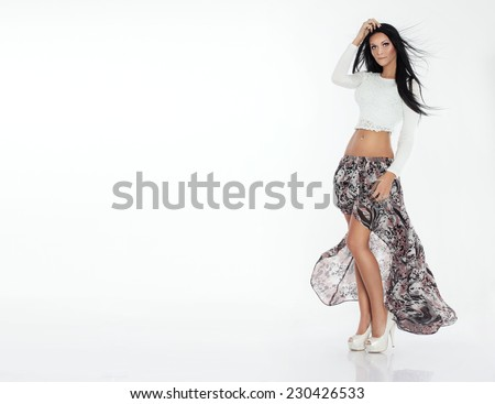 Fashionable beautiful brunette woman posing in studio. - stock photo