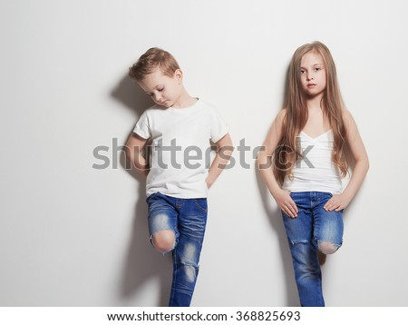 fashionable beautiful little couple. beauty girl and boy together - stock photo