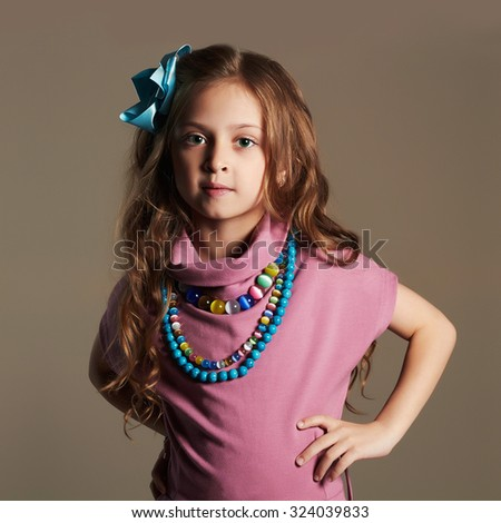 fashionable beautiful little girl.pretty little lady in dress and flower in healthy hair - stock photo