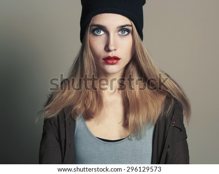 fashionable beautiful young woman in cap. beauty blond girl in hat. casual wear - stock photo