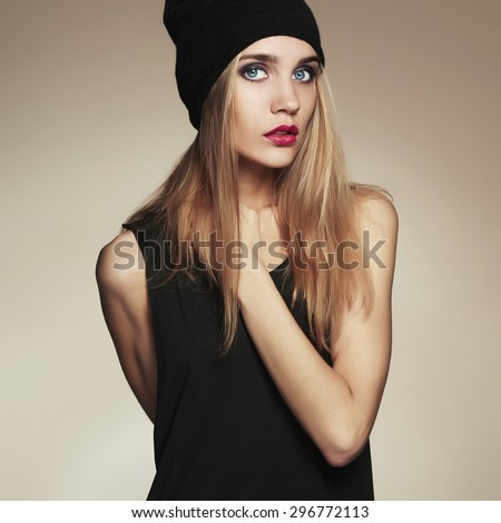 fashionable beautiful young woman in hat. beauty blond girl in cap. casual wear.autumn fashion collection - stock photo
