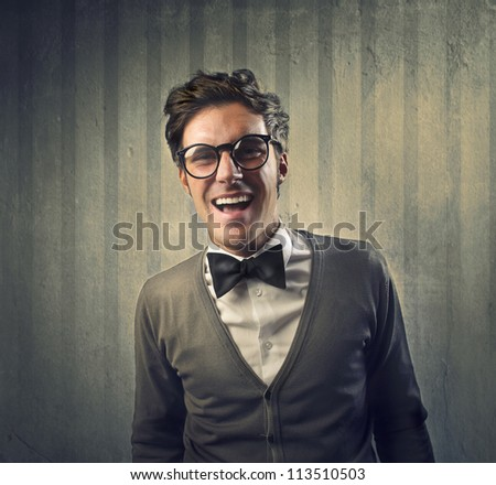 Fashionable boy laughing for something funny - stock photo