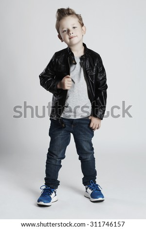 Fashionable child in leather coat.little boy. Autumn fashion.funny kid - stock photo