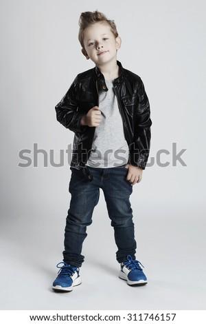Fashionable child in leather coat.little boy. Autumn fashion.funny kid - stock photo