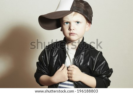 Fashionable Child.stylish little boy in tracker Cap.fashion children.handsome serious kid with big blue eyes.Tracker Hat. 4 years old - stock photo