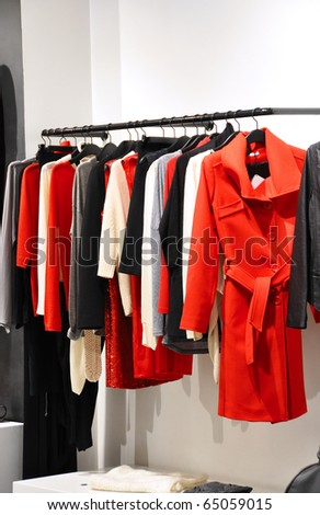 Fashionable clothes hanging in a  store - stock photo