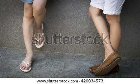 Fashionable cool couple, legs, lifestyle - concept - stock photo