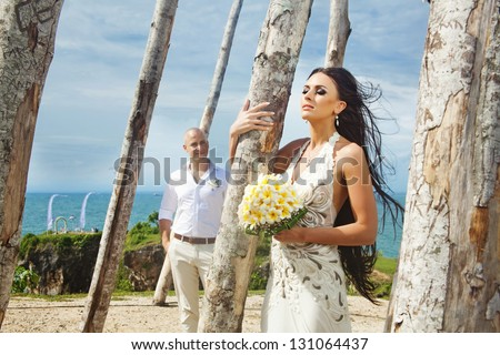 Fashionable couple on wedding day - stock photo