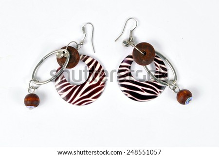 Fashionable earrings on the white background - stock photo