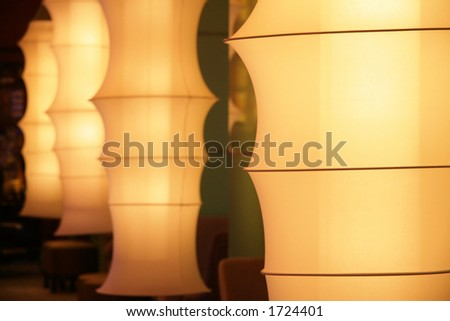 Fashionable fabric tubed lamps at a bar lounge - stock photo