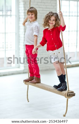 Fashionable girl and boy - stock photo