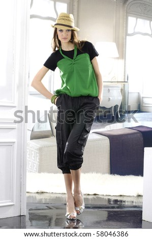 fashionable girl with retro hat in the studio - stock photo