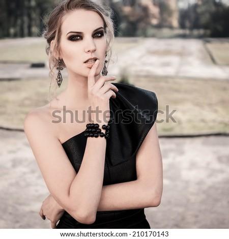 Fashionable gothic girl - stock photo