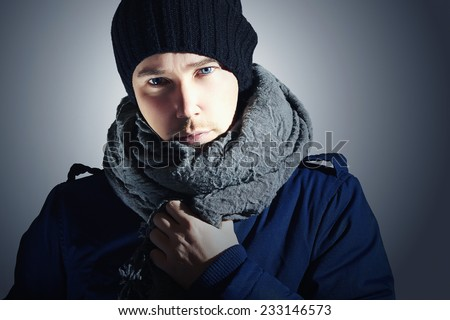 Fashionable Handsome Man in Scurf. Stylish Boy with Blue Eyes. Casual Winter Fashion - stock photo