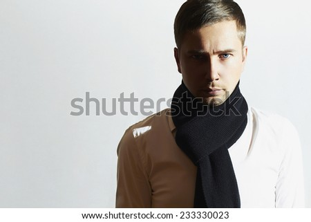 Fashionable Handsome Young Man in scarf. Stylish Boy. Casual Winter Fashion - stock photo