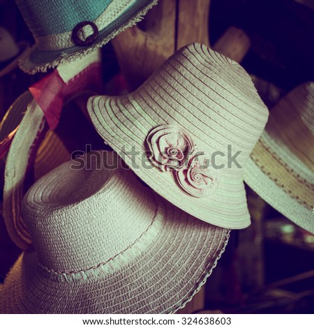 Fashionable hat hang in the shop, vintage style effect - stock photo