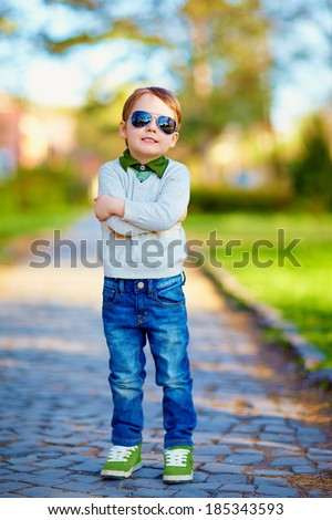 fashionable kid in summer park - stock photo