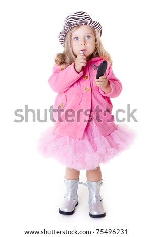 Fashionable kid with lipstick  and mirror isolated on white - stock photo