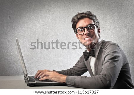 Fashionable man using a laptop computer - stock photo