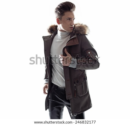 Fashionable man wearing winter jacket - stock photo