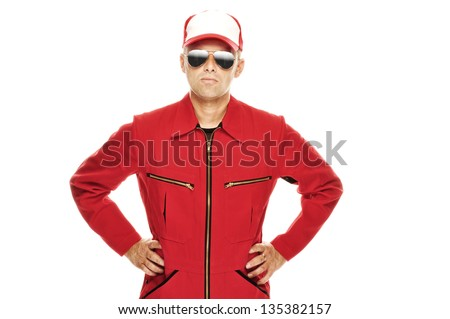 Fashionable mechanic in red Overall with cool sunglasses - stock photo